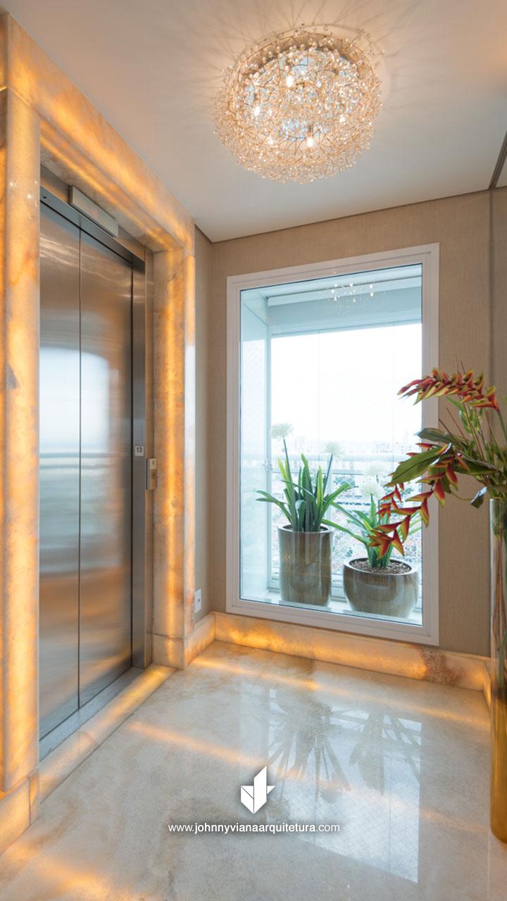 Hall de entrada com mármore iluminado   Johnny Viana Arquitetura e Interiores